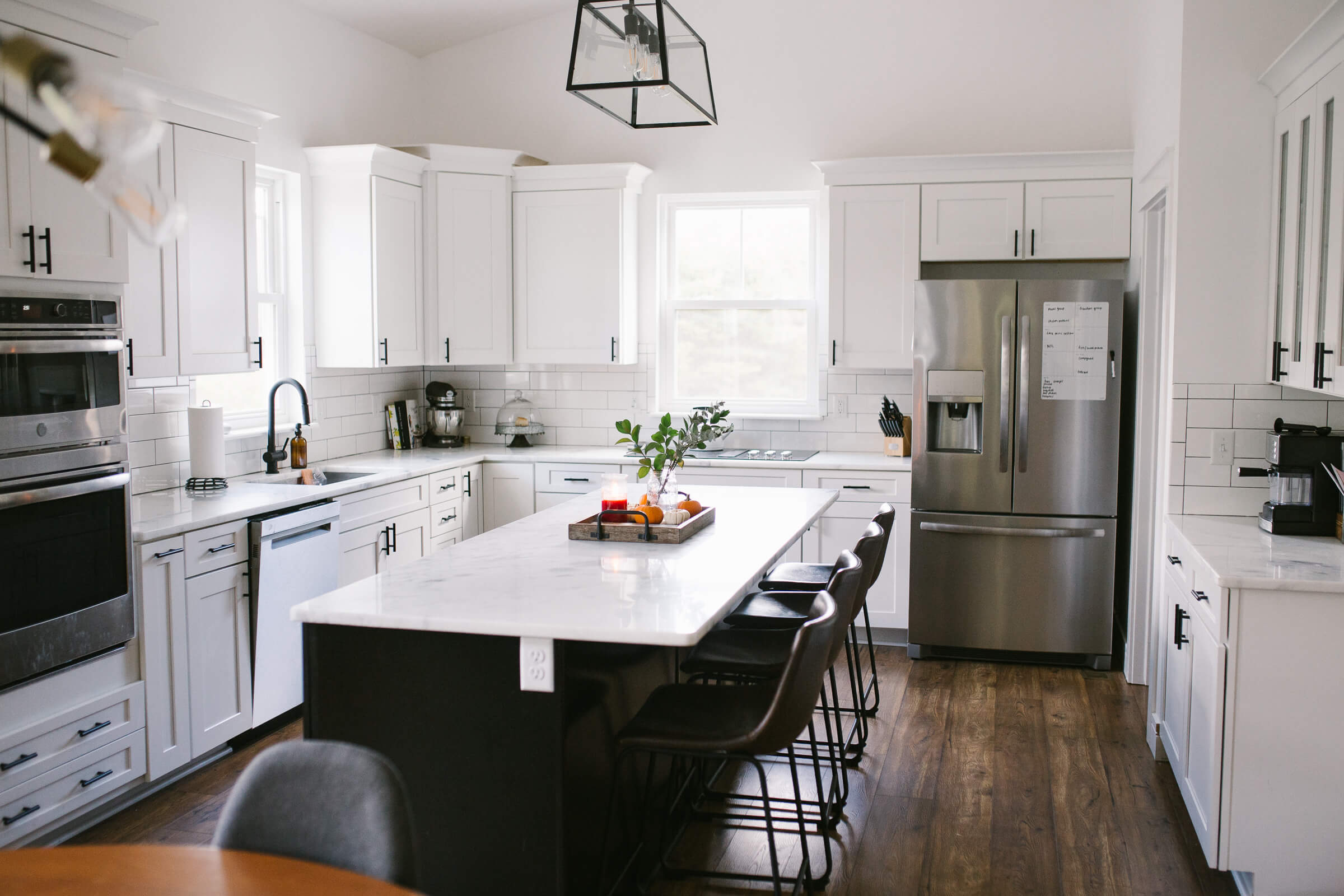 white kitchen with white cabinets and black cabinet pulls