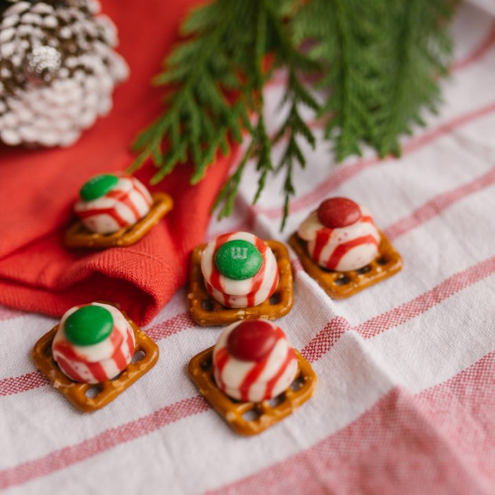 pretzel snaps with peppermint hershey kisses and green and red m&ms
