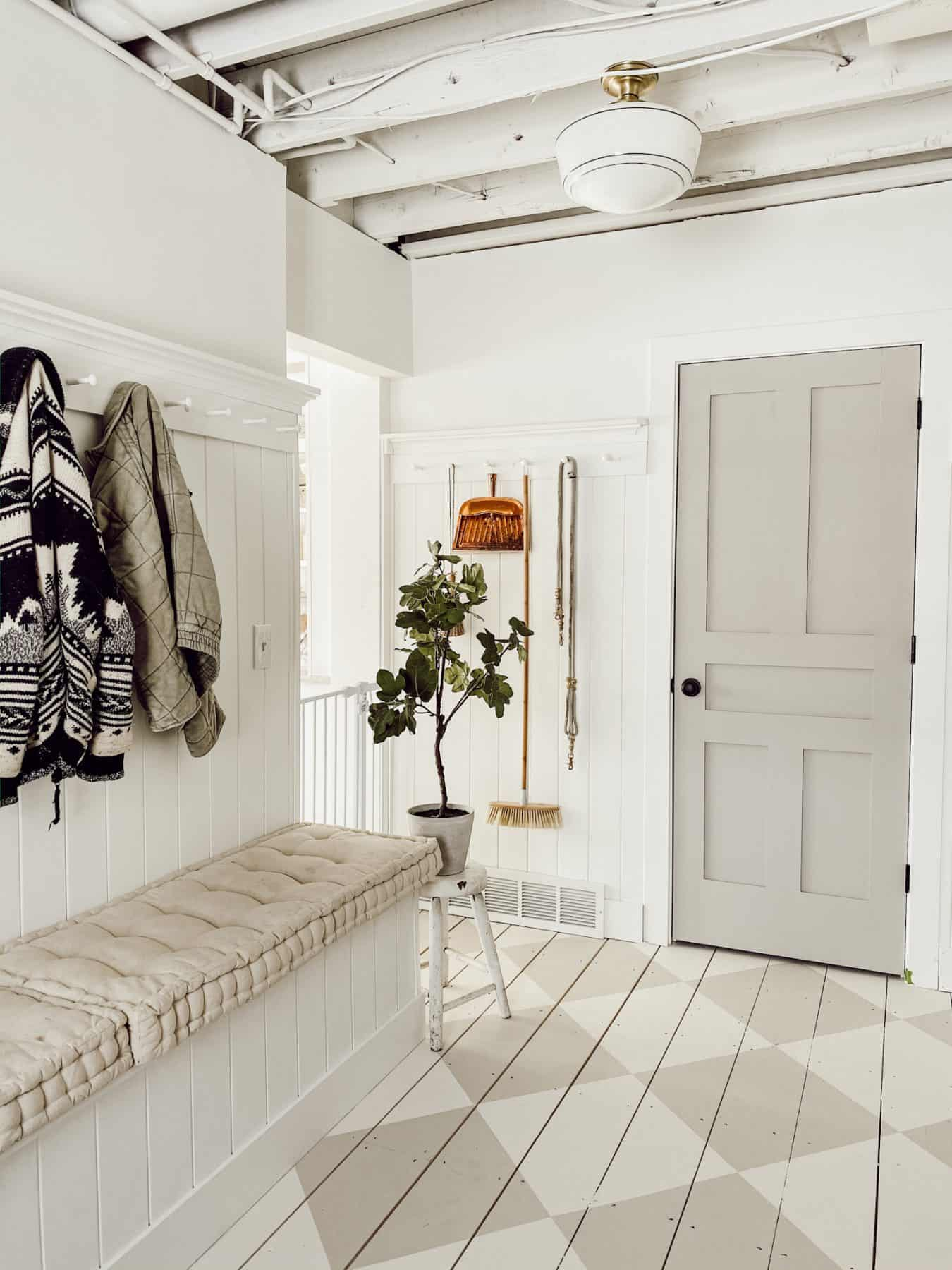 front entryway with closet and hooks for jackets