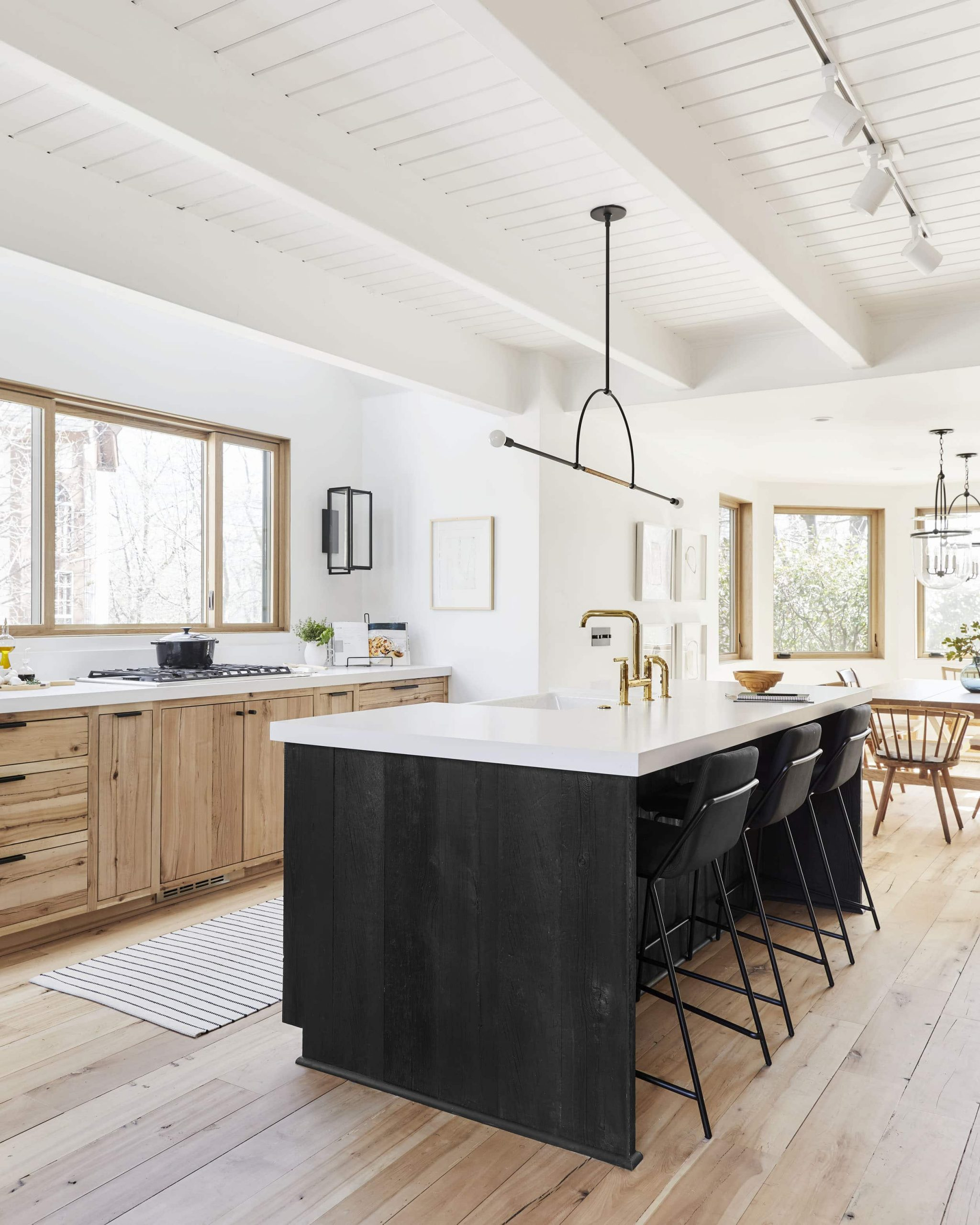 black and wood Scandinavian kitchen with bright windows and wood accents