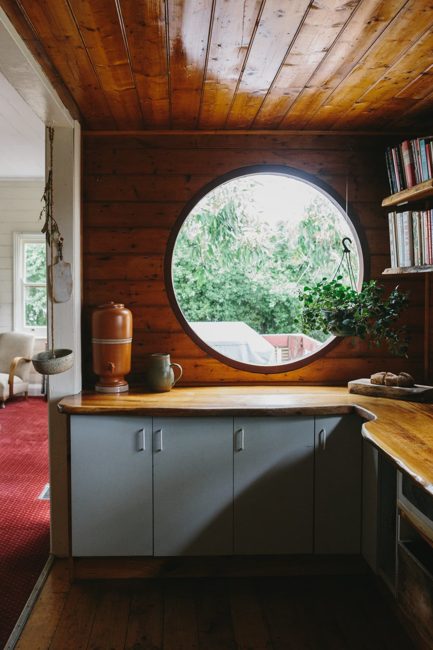 wood scandinavian kitchen with gray cabinets, large windows and open shelving