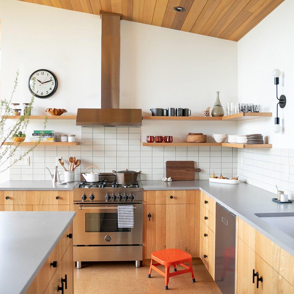 eclectic modern scandinavian kitchen with subway tile backsplash and gray countertops