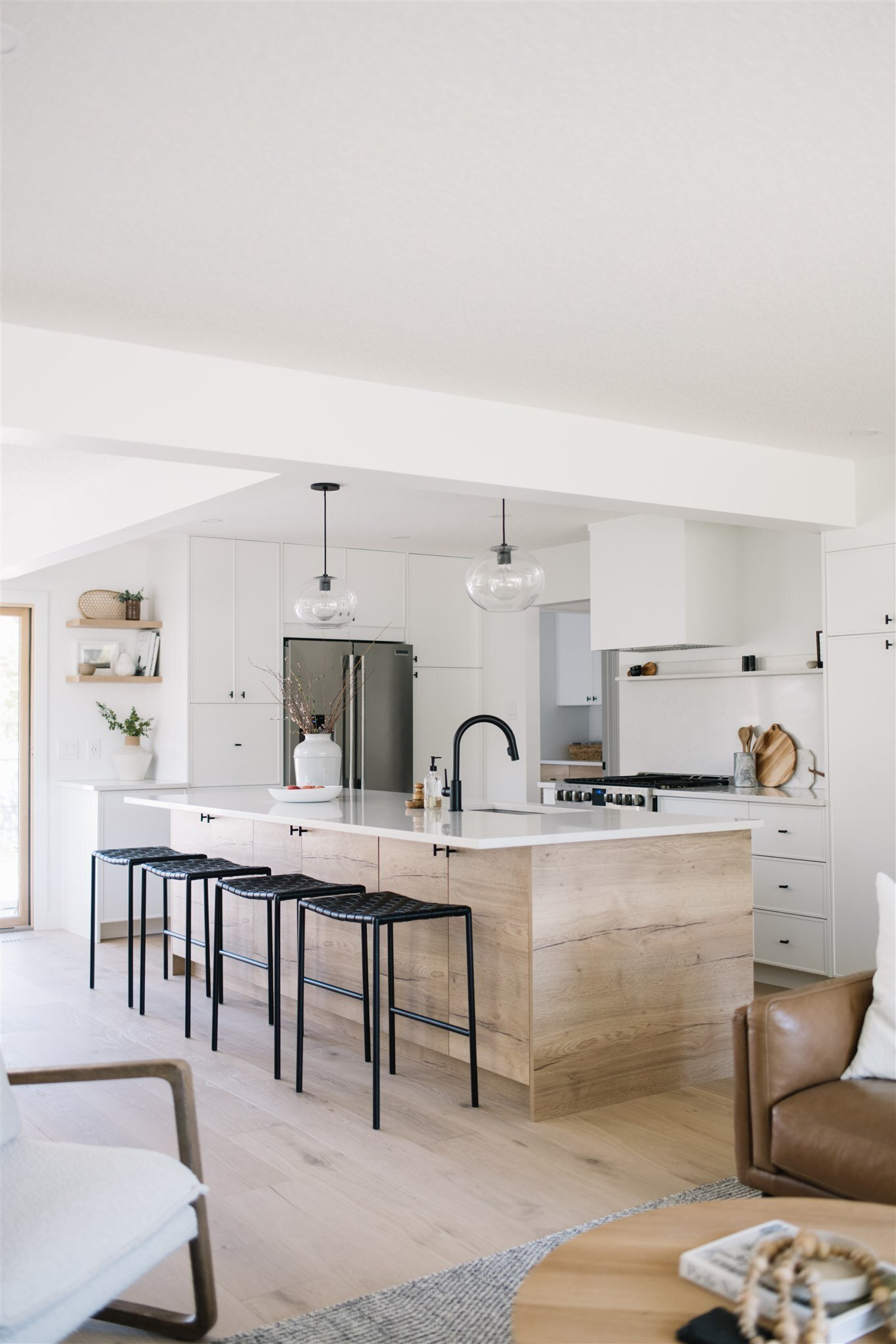 white cabinets and white countertops in a scandinavian style kitchen