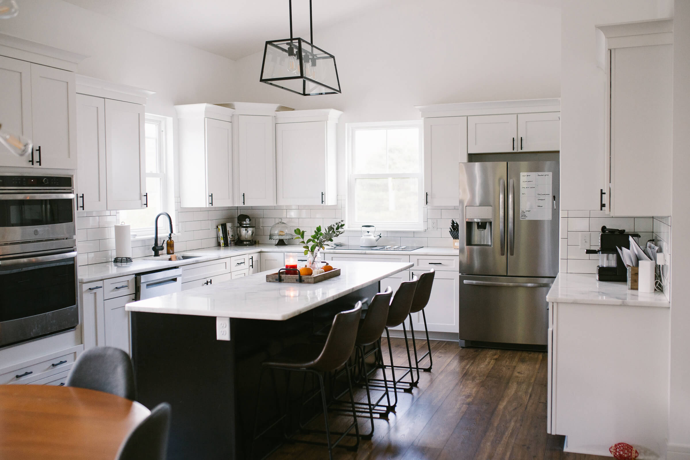 modern white kitchen with black island and white cabinets