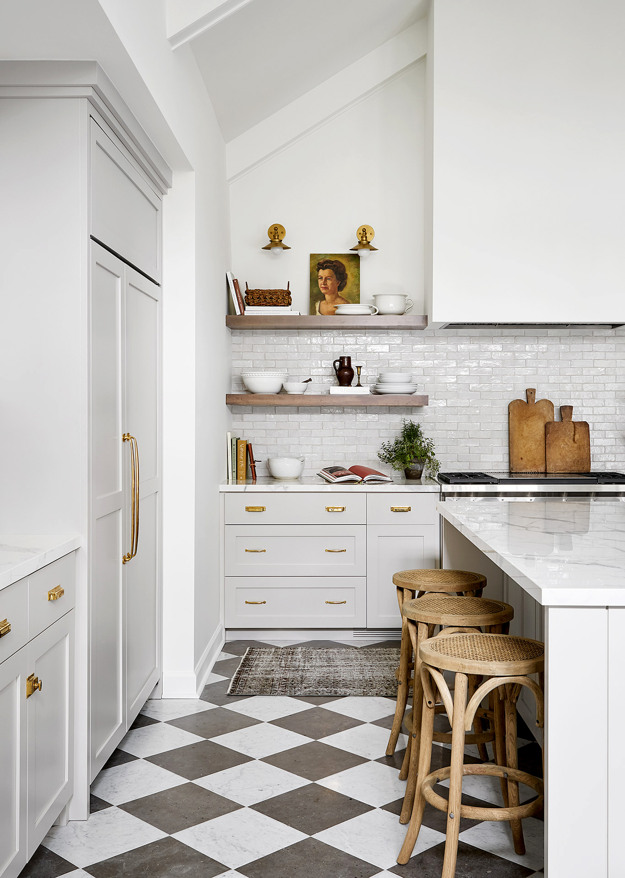 white kitchen with black and white checkerboard tile floors with quartz countertops and a large island