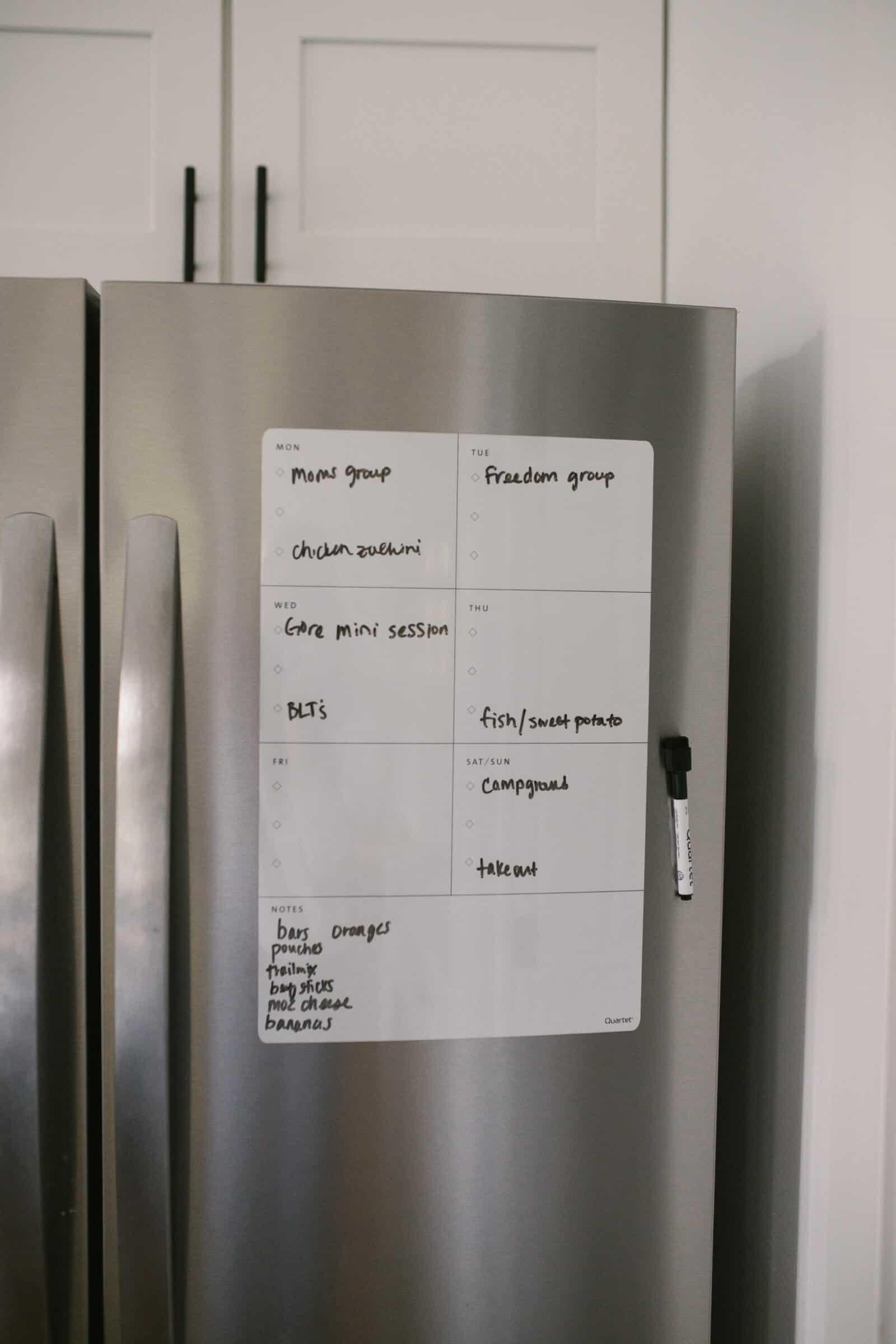 magnetic weekly planner on stainless steel fridge