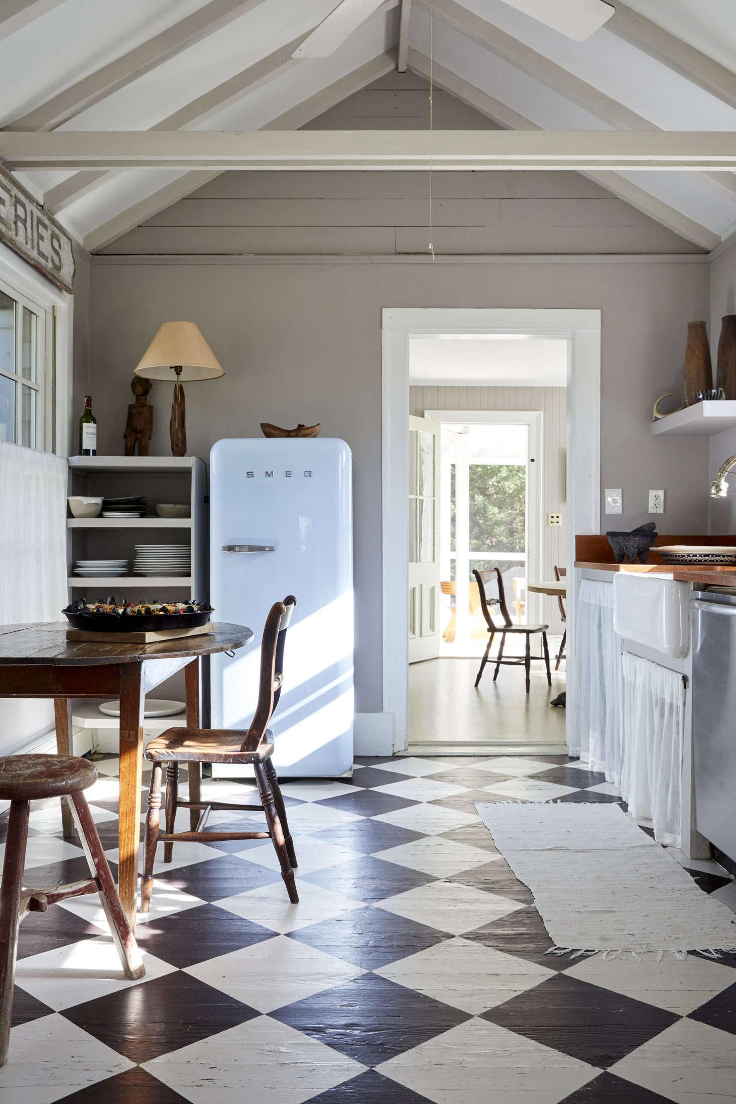 black and white floors with a smeg fridge and kitchen skirt
