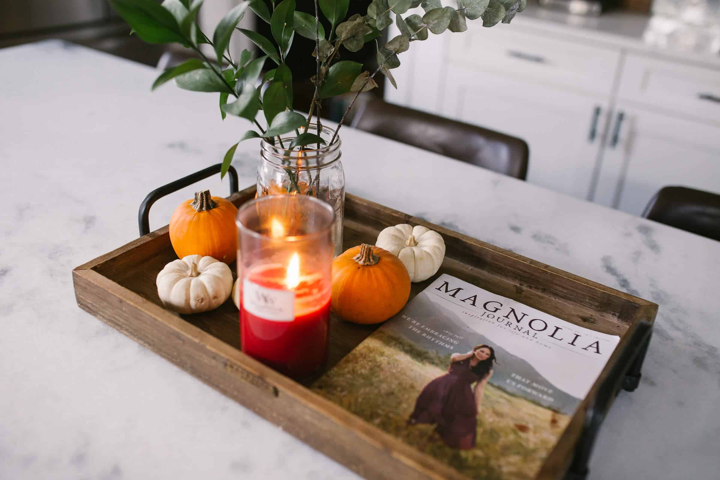 wood tray in kitchen on marble countertops with magnolia journal