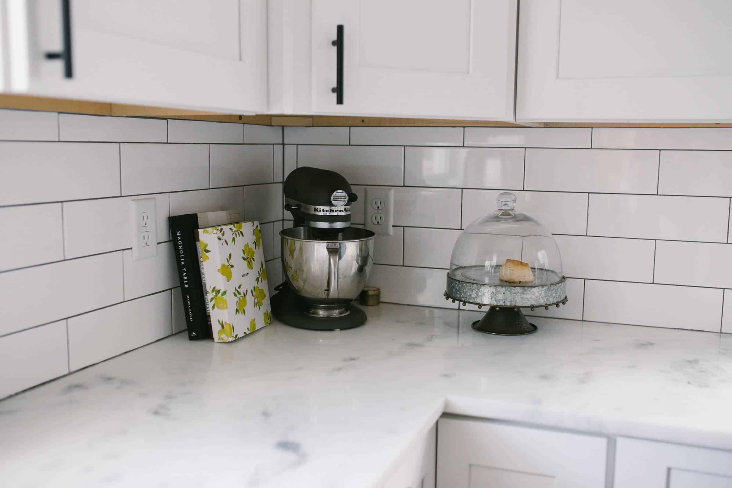 white kitchen cabinets in a modern white kitchen with kitchenaid mixer