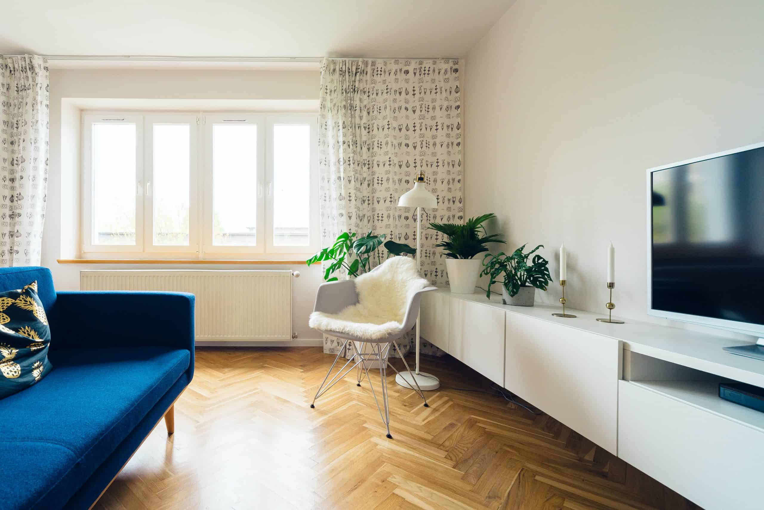 living room with wood floors and white walls