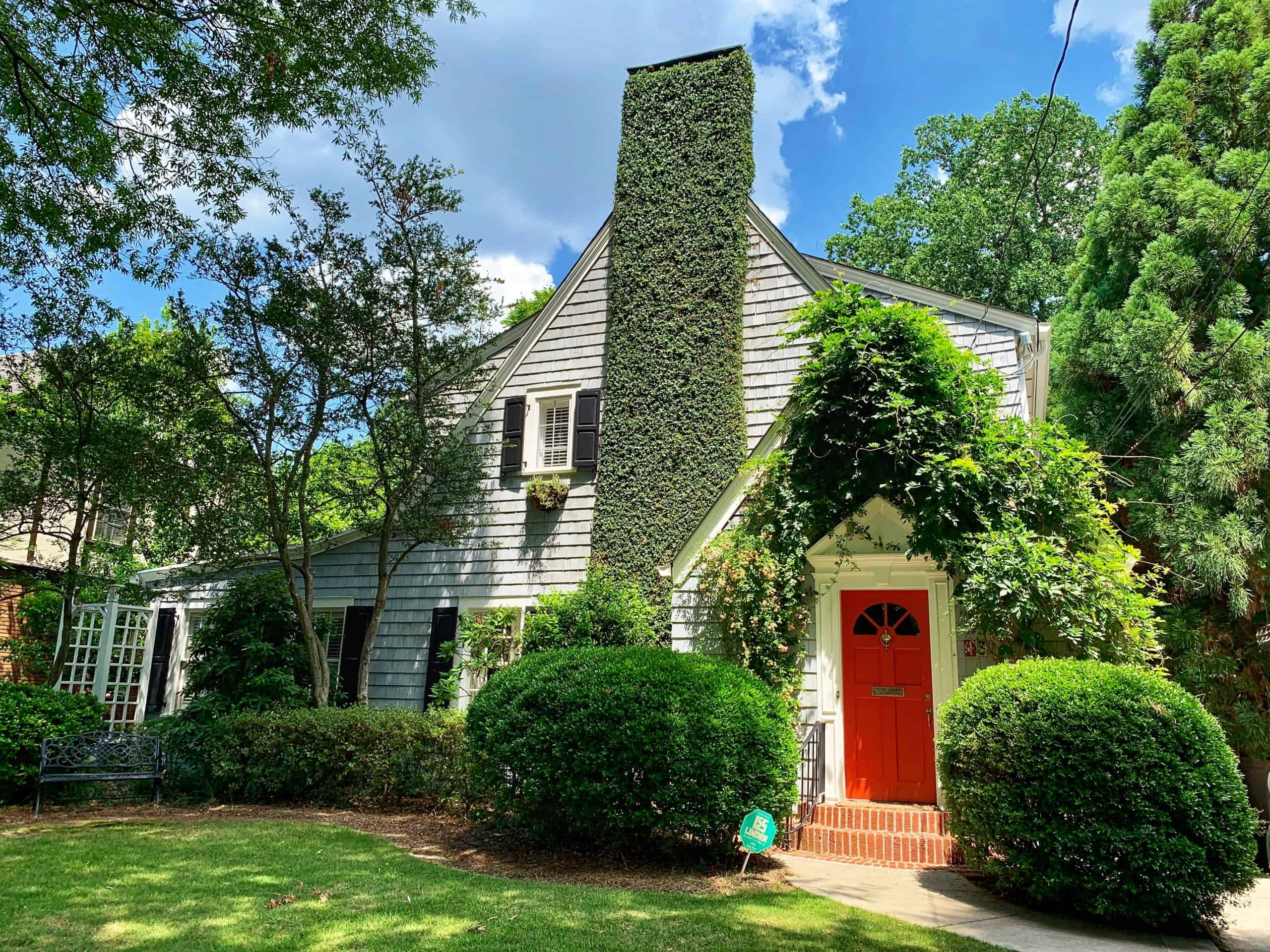 gray colonial house with shaker siding and ivy for a first time home buyer