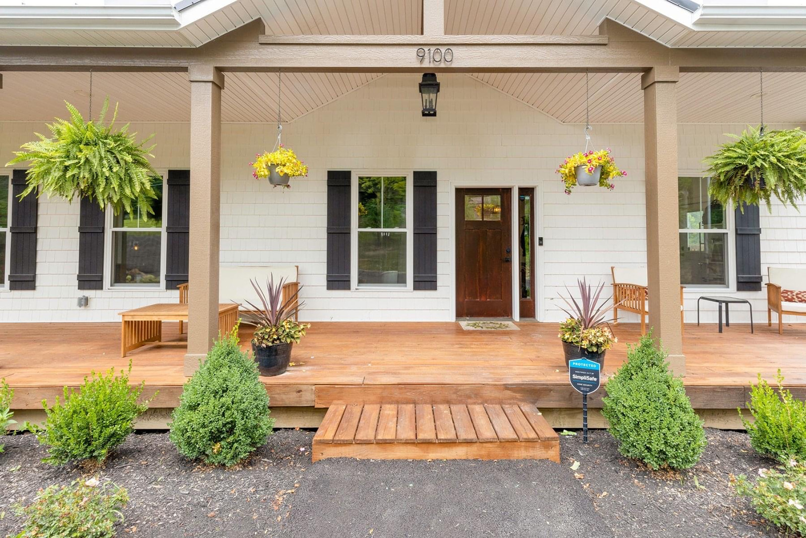 Brand new exterior of home with a farmhouse feel. New home build