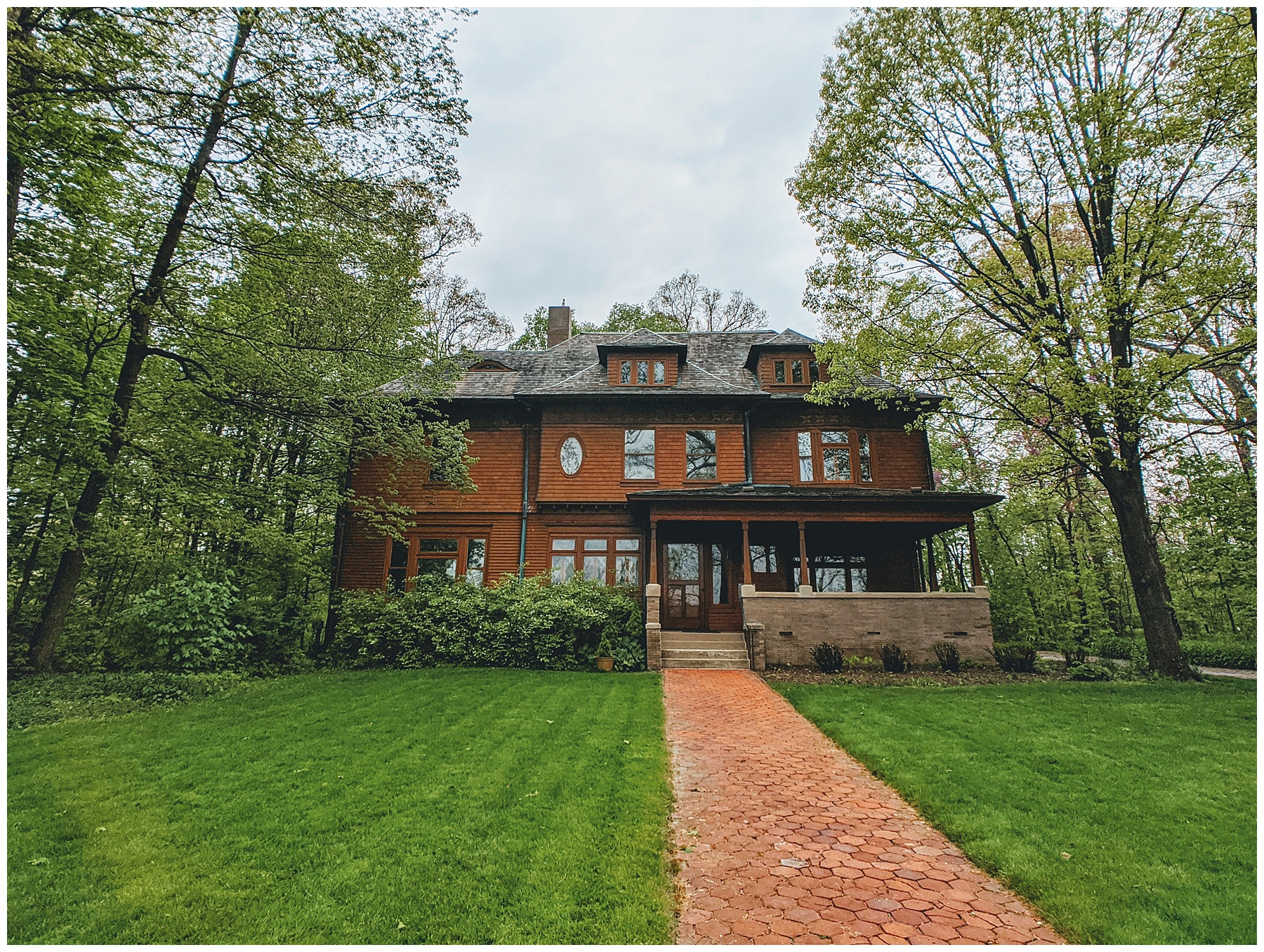Older style home with character and charm and brick path to house front.
