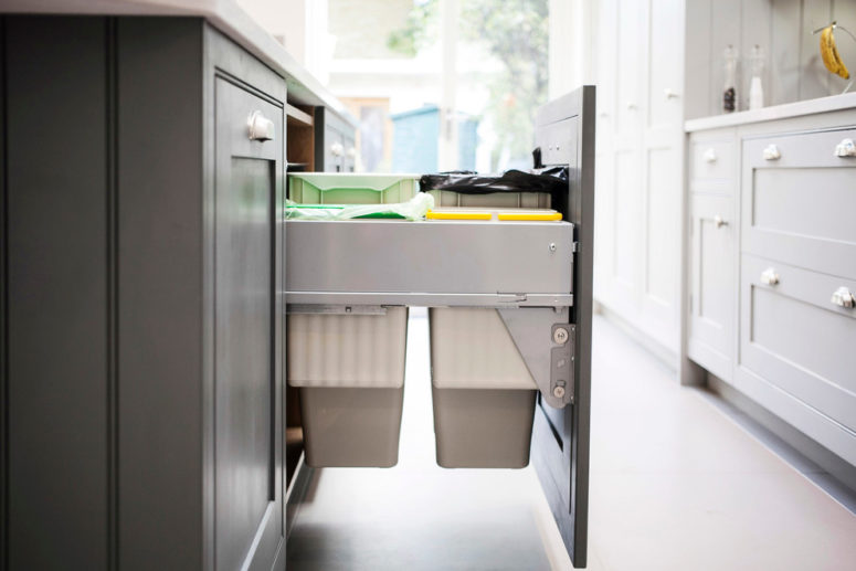 Hidden pull out trash can in kitchen -  10 must have items when building or renovating a home